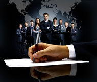 Businessman's hand with pen яяя Royalty Free Stock Images