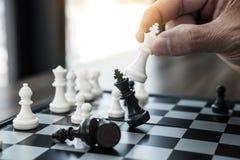 Free Businessman`s Hand Playing Chess Game To Development Analysis Ne Royalty Free Stock Photo - 129090265