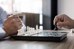 Businessman`s hand playing chess game to development analysis new strategy plan, business strategy leader and teamwork concept fo stock photos