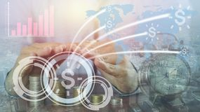 Businessman `s hand proctect pile of money coin and connect ,collaborate , success in capital finace. Around the world concept Stock Photo