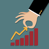Businessman's hand pull the peak of graph. Business concept. Royalty Free Stock Image