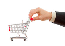 Businessman's hand pushes shopping cart. Isolated studio shot Stock Image