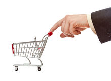 Businessman's hand pushes shopping cart. Isolated studio shot Royalty Free Stock Photos
