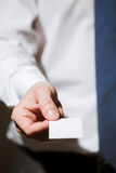 Businessman's hand reaching out a business card Stock Photo
