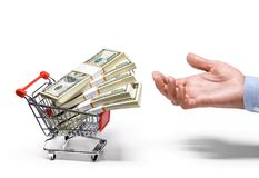 Businessman's hand & shopping cart full of stacks of american dollar banknotes - isolated on white background. Man's hand invites the cart full of money Royalty Free Stock Images