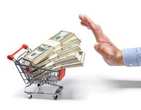 Businessman's hand & shopping cart full of stacks of dollar bills - isolated on white background Stock Image