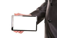 Businessman's hand showing a tablet pc comuter with blank screen for your sample text Stock Image