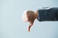 Businessman's Hand Showing Thumbs Down Stock Photo