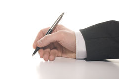 Businessman's hand signing Royalty Free Stock Photo