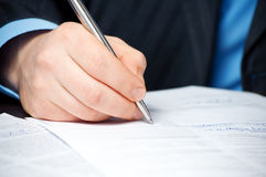 Businessman`s hand signing contract Royalty Free Stock Images