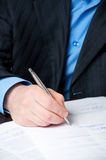 Businessman`s hand signing contract Royalty Free Stock Photo