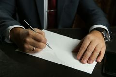 Businessman`s hand writes with fountain pen closeup. stock images