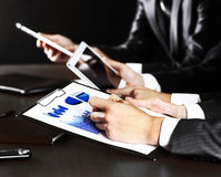 Businessman's hand writing in the document. Close-up picture of businessman's hand writing in the document Royalty Free Stock Images
