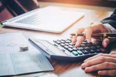Businessman's hands with calculator and cost at the office and F. Businessman's hands with calculator and cost at the office and Financial data Stock Images