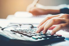 Businessman`s hands with calculator at the office and Financial data Cost Economic Royalty Free Stock Image