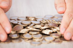 Businessman's Hands Collecting Euro Coins Royalty Free Stock Photo