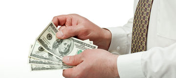 Businessman's hands counting dollar banknotes Stock Photography