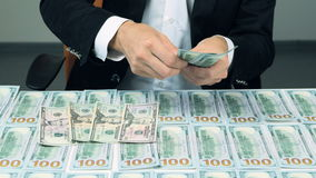 A businessman's hands counting US dollar bills and put them on the table. Money background. stock footage
