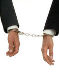 Businessman's Hands In Handcuffs. Isolated Royalty Free Stock Images