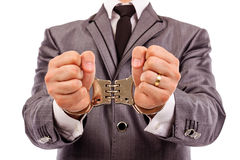 Businessman's hands with handcuffs Stock Images