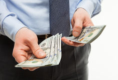 Businessman's hands holding dollar banknotes Stock Photo
