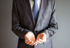 Businessman's hands holding something Royalty Free Stock Images