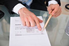 Businessman's Hands Pointing At Invoice Stock Image