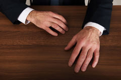 Businessman's hands put on the desk Royalty Free Stock Photo