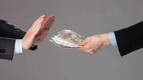 Businessman's hands rejecting a bribe Royalty Free Stock Photo