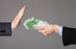 Businessman's hands rejecting an offer of money Royalty Free Stock Image