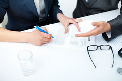 Businessman's hands signing a contract Stock Photos
