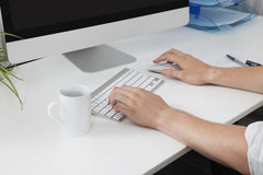 Businessman's hands using computer at desk Royalty Free Stock Photography