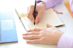 Businessman's hands writing in a notepad Royalty Free Stock Images