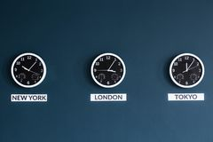 Businessman`s home office with clocks stock images