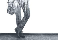 Businessman's legs and forest double exposure b/w image Stock Photo