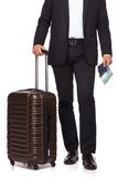Businessman's legs and travel suitcase Royalty Free Stock Photos