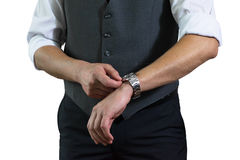 The businessman's photo in a white shirt and a gray vest. The man clasps hours Stock Images
