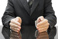 Businessman's protecting hands stock photography