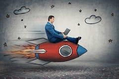 Businessman`s rocket speed stock images