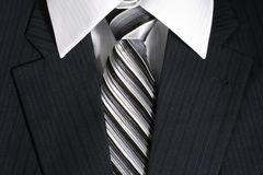 Businessman's suit. Detail of dark grey businessman's suit royalty free stock photo