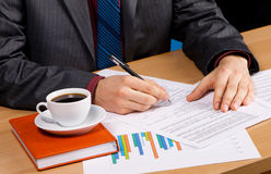Businessman's table covered with documents Royalty Free Stock Image