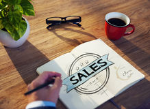 Businessman's table with Sales Concept Royalty Free Stock Image