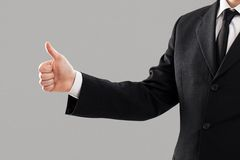 Businessman's torso with thumb up Stock Photos