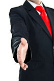 Businessman's welcome gesture. Young businessman stretching his hand for handshake Royalty Free Stock Photos