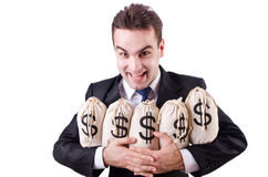 Businessman with sacks of money Royalty Free Stock Image