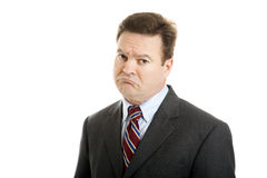 Businessman So Sad. Businessman with a very sad, sarcastic expression of mock sympathy. Isolated on white Stock Image