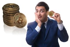The businessman sad about bitcoin price crash. Businessman sad about bitcoin price crash royalty free stock photography