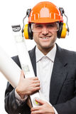 Businessman in safety hardhat helmet holding paper drawings plan Stock Photography