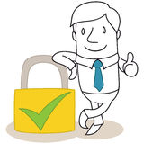 Businessman with safety lock giving the thumbs up Stock Photography