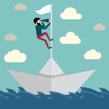 Businessman is sailing on paper boat in ocean Royalty Free Stock Images